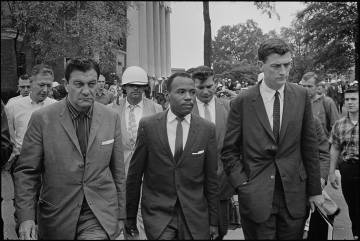 James Meredith walks to class at the University of Mississippi in 1962, accompanied by U.S. Marshal James McShane (left) and John Doar of the Justice Department. Photo by Marion S. Trikosko, U.S. News & World Report, via Wikimedia Commons.