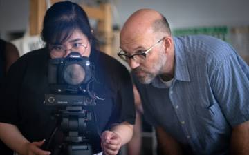 Jim Haverkamp, rights, helps Mara Guevarra, digital marketing and projects manager for Duke's Center for Documentary Studies, film during a class at CDS. Photo courtesy of Jim Haverkamp.