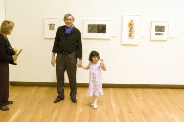 Irwin Kremen with his granddaughter at the opening of the 2007 Nasher Museum retrospective.