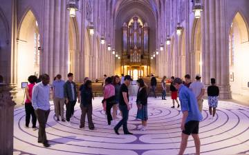Duke community members take part in the labyrinth walk in the Duke Chapel. The self-guided walk is an ancient spiritual practice of meditation and self-centering found in religious traditions from around the world.