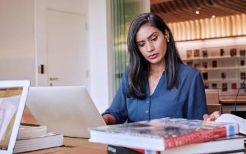 Woman at a computer.