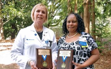 Duke Radiology's Marie Stone, left, and Duke Regional Hospital's René Livingston Flowers were honored as Return-to-Work MVPs.