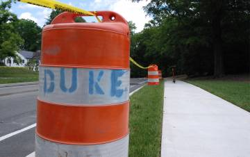 Construction barrels line Campus Drive. Photo by Stephen Schramm.