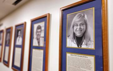 Debra Sudan's portrait, far right, hangs among the other Duke Surgery Master Surgeons. Photo courtesy of Duke Surgery.