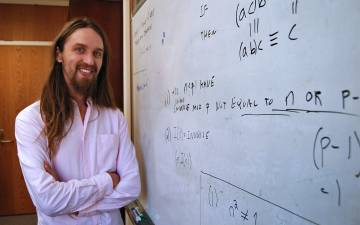 Matt Junge in front of a whiteboard.