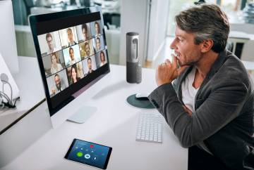 Video meetings with multiple people require more attention to focus on facial expressions and cues than in-person conversations and come with distractions such as noise and virtual background visuals. Photo courtesy of Zoom.