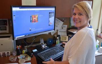 """Jennifer Chamberlain listens to Pandora playlists like """"Relaxation Radio"""" at work. Photo by Jonathan Black."""