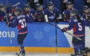 Randi Griffin, left, celebrates her goal against Japan in the Winter Olympics with teammates on the Korean women's ice hockey team. Photo courtesy of the Korean Ice Hockey Association.