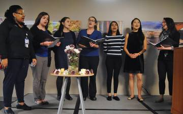 First-year students from Duke's School of Medicine sing during a memorial service for the people who made donations through the Anatomical Gifts Program.