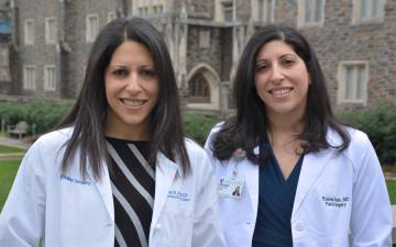 Amy Alger, left, and Kristen Rezak, right, are identical twins and surgeons for Duke Health. Photo by Jonathan Black.
