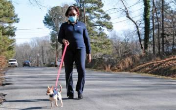 Wanda Amons and her dog, Cola, take a walk near Amons' Durham home. Photo by Stephen Schramm.