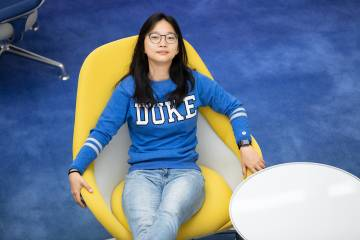 Angie Xie, a freshman at Duke University, poses for a portrait at the Innovation Building lobby at Duke Kunshan University, Thursday, Apr. 29, 2021. Xie said it is one of her favorite places on campus. (Photo/Qiling Wang)