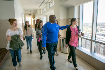 John Blackshear leads students on a tour as part of his SpringBreakthrough class on forensic psychology.