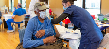 A man receives a COVID-19 vaccine.