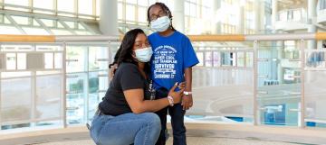 Sharday (left) and Ja'Kye Mason (right) pose together at Duke Hospital.