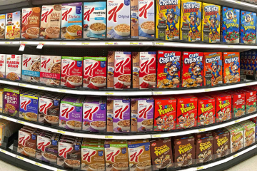 Racks of cereal in a grocery store