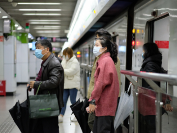 Masked Chinese residents in subway station