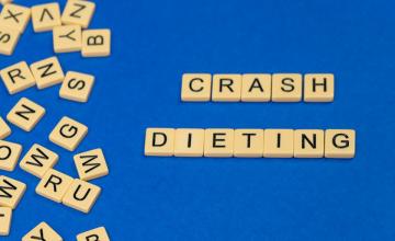 scrabble tiles spelling out crash diet