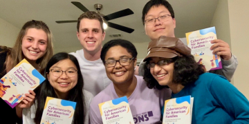 Matt and his teammates show off their cybersecurity guide. Top row (L to R): Sabrina Pin, Matt Phillips, David Liu; bottom row (L to R) Mary Wang, Analese Bridges, Shreya Hurli