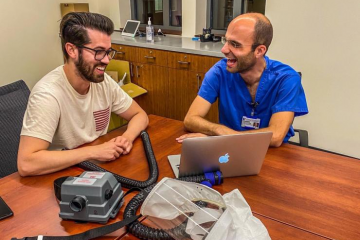 Design Health Fellows Alejandro Pino (left) and Konstantinos Economopoulos (right) collaborating on a presentation for the PAPR Bridge Project. Picture taken by Theresa Thompson