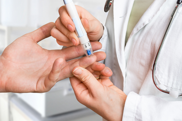 a finger prick to measure blood sugar
