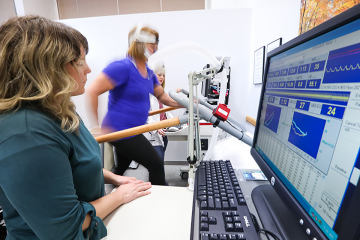 From left, exercise physiologist Grace McDonald, study participant Sally Morgan, and exercise physiologist Megan Reaves during Morgan's clinical exercise test at the Duke Center for Living.