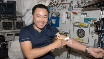 Expedition 32 Flight Engineer Akihiko Hoshide after undergoing a generic blood draw in the European Laboratory/Columbus Orbital Facility. Duke engineers are building a robot that would replace the need for specialized astronaut training to access a vein f