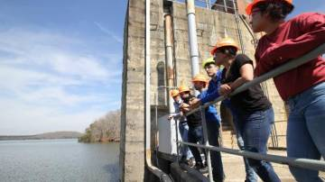 Faculty member Neal Simmons (far left) leads students on a tour of Cube Hydro's Badin Lake facility. Students, left to right: Uriel Salazar, Laura Perez, Sahil Mehta, Hunter McNamara, and Laura Perez. Perez will intern at Cube Hydro this summer.