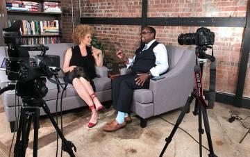 Mark Anthony Neal, right, interviews writer Michaela Angela Davis on