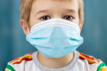 stock photo of child wearing mask