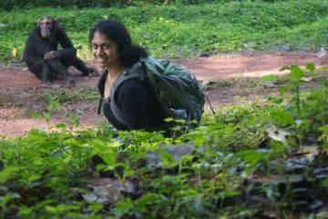 Rachna Reddy and a primate acquaintance in Uganda.
