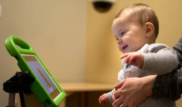 baby looks at computer screen during autism testing