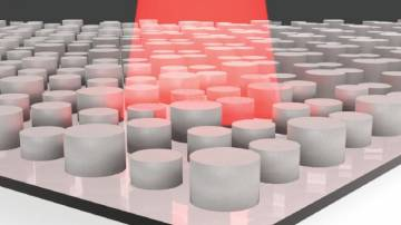 An illustration of a dielectric metamaterial with infrared light shining on it.