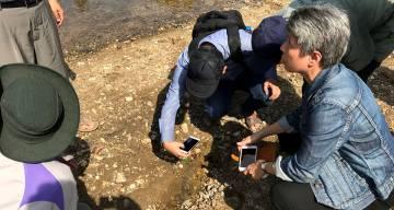 Nyunt examines mosquito larvae at a teak plantation in Myanmar's Mandalay Region.