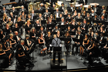 Paul Bryan conducts the Wind Symphony and alumni in a 2013 concert honoring him.