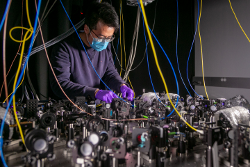 Lu Qi, an Electrical and Computer Engineering Postdoctoral Fellow in the Brown Lab works on a quantum computer setup.