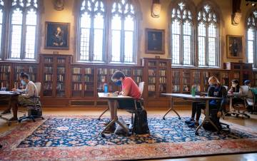 Wearing masks and physically distanced, students study in the Gothic Reading Room of Perkins Library. Photo by Jared Lazarus, Duke University Communications.