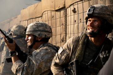 "Scott Eastwood, right, in a scene from ""The Outpost."" The film tells the story of the 2009 Battle of Kamdesh in Afghanistan.Credit...Screen Media, via Associated Press"