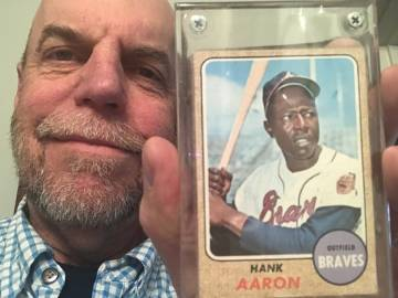 Charlie Thompson with his Hand Aaron baseball card from 1969