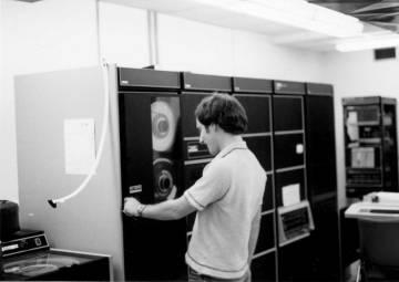 Jim Ellis mounting a magtape on the Duke CS department minicomputer; photo courtesy of Tom Truscott