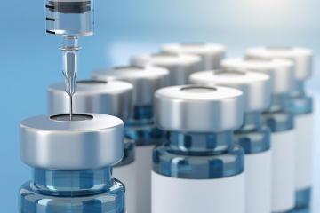 Vaccine vials being filled