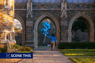 Duke Senior Ana Markey walks on West Campus with Duke Blue Valentine's heart-shaped balloons.