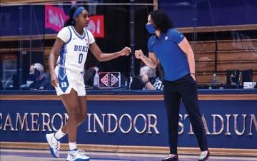 Coach Kara Lawson talks with guard Jaida Patrick during a game this season. Photo courtesy of Duke Athletics.