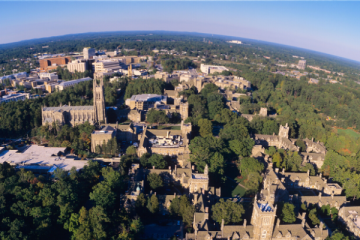Wide aerial of Duke campus, centered on Duke Chapel and West Campus
