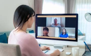 A person taking colleagues in a Zoom meeting.