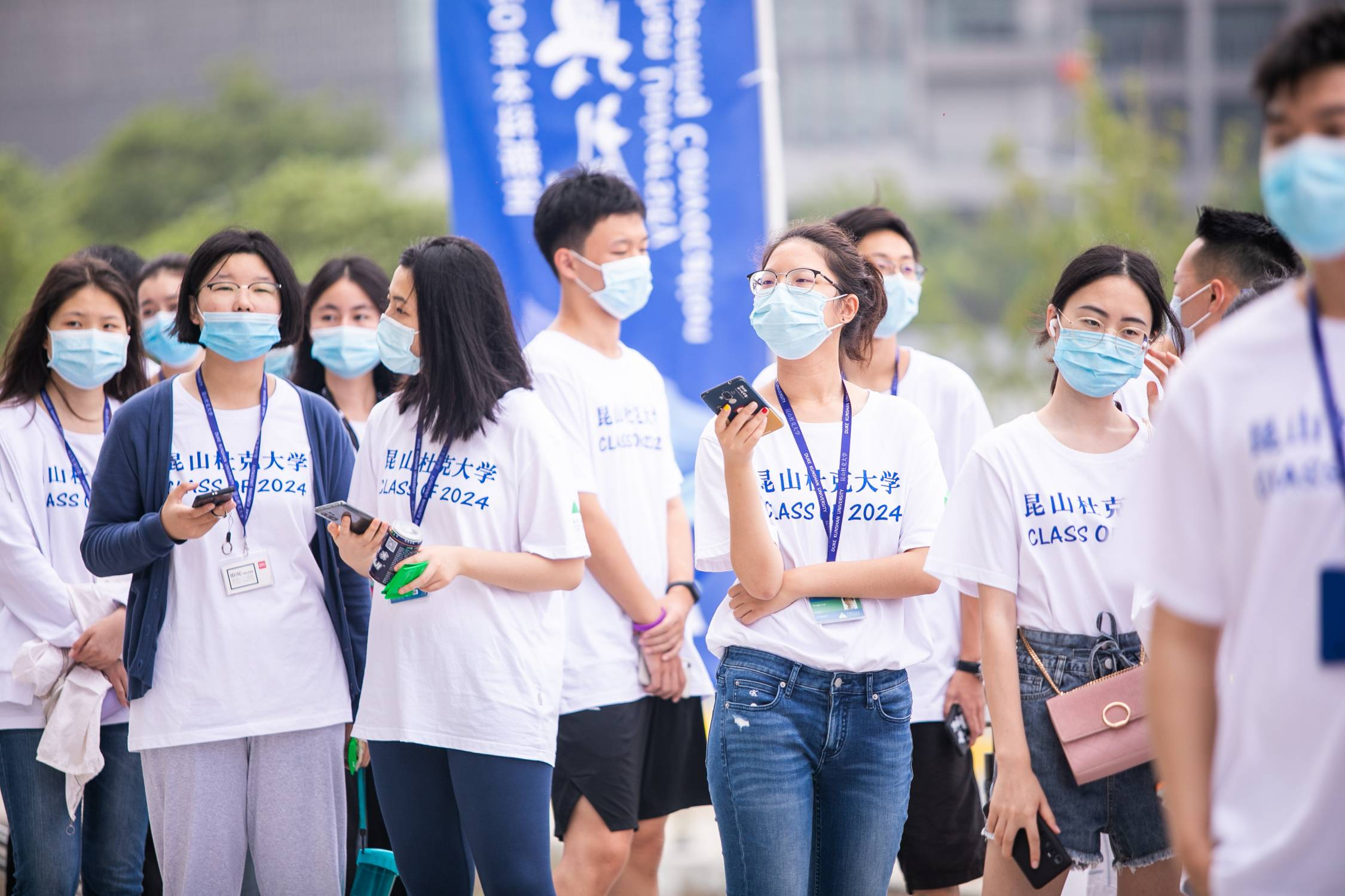 Students wearing masks to DKU Convocation.